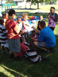 Joey Hamick of North Carolina sharing the Lord with children at the block party for Hope in Christ Assembly